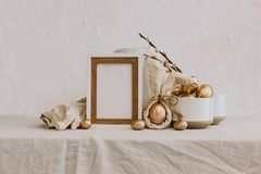 Easter Rustic Mock Up. Gold Egg With linen rustic background. royalty free stock photo