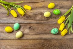 Easter yellow green eggs and tulips, copy space stock images