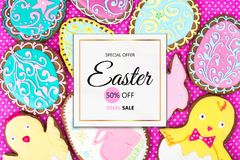 Easter sale. Background of bright cookies in the form of eggs stock photo