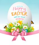 Easter Sale Background. Colofrul eggs in green grass and flowers. Vector Royalty Free Stock Image