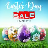 Easter sale banner with ornamental easter eggs in the grass Royalty Free Stock Photography