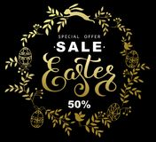 Easter sale banner with wreath golden leaves and  easter bunny o. N black background Stock Photography