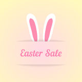 Easter sale with ears in pocket. Concept of special offer, shopping, marketing ploy, profitable proposition. isolated on cream background. flat style trendy Stock Photos