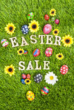 Easter sale eggs on grass vertical Stock Photos