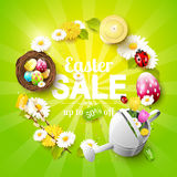 Easter sale flyer. With flowers, Easter eggs and watering can on green background Royalty Free Stock Photography