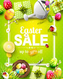 Easter sale flyer. With flowers, Easter eggs and watering can on green background Royalty Free Stock Photo