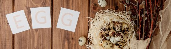 Free Easter Sale Message With Easter Eggs On A Wooden Background. Top View Royalty Free Stock Photography - 172724677