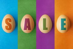 Easter sale offer, banner template. Eggs with lettering on colored background. Easter eggs sale. Spring shop market poster design royalty free stock photo