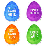 Easter sale, offer, discount and price in eggs. Easter sale, offer, discount and price banners - four colors eggs labels with spring daisy flowers, business Stock Photography