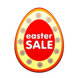 Easter sale in red egg shape label with flowers. Easter sale banner - 3d red egg shape label with white text and flowers, business concept Royalty Free Stock Photos