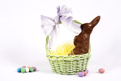 Easter Scene. A pretty easter basket with chocolate bunny stock photography