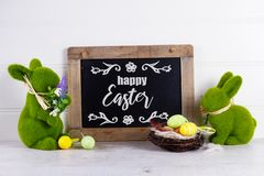 Easter scene with colored eggs royalty free stock images