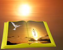 Easter scene of Gold Bible on sunrise. Easter scene of Gold Bible on beautiful sunrise background.  Jesus in the egg shining holy light approaching to us from Stock Image