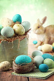 Easter scene with speckled eggs in bowl Stock Photo