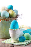 Easter scene with turquoise speckled egg in cup stock images