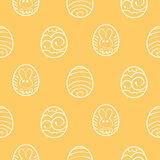 Easter seamless background. Decorated eggs on a yellow backgroun Stock Photos