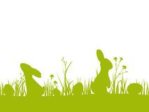 Vector Easter seamless border with silhouettes of rabbits, eggs, flowers and grass. For design holiday greeting card or invitation. Isolated from the Royalty Free Stock Images