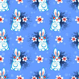 Easter seamless-17. Easter bunny and flowers on blue background. Seamless pattern for wrapping paper or textile print stock illustration