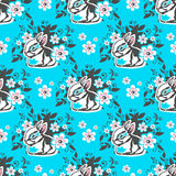Easter seamless-20. Easter bunny and flowers on blue background. Seamless pattern for wrapping paper or textile print Stock Illustration