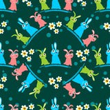 Easter seamless-24. Easter bunny and flowers on dark background. Seamless pattern for wrapping paper or textile print Royalty Free Stock Photo