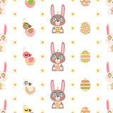 Easter seamless pattern. With cute cartoon rabbits and birds on a white background Stock Photos