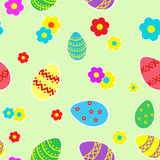 Easter seamless pattern. Of colored eggs on a light green background Stock Image