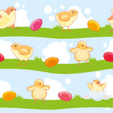 Easter seamless pattern with cute cartoon chickens and colored eggs on the background of lawn and sky. Royalty Free Stock Photo