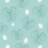 Easter seamless pattern rabbits holding eggs Blue Stock Image