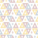 Easter seamless vector pattern with painted eggs and triangles stock photo