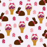 Easter seamless wallpaper. Chocolate bunny with Easter basket and Easter eggs. Beautiful vector pattern. Can be used for wallpaper, background, surface texture Stock Photography