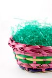 Easter series - basket 5. Brightly colored easter basket with green holiday grass Stock Photography