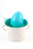 Easter series - egg. A plastic easter egg in a floral tin bucket Stock Photos