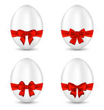 Easter set celebration egg wrapping red bow Stock Photos