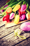 Easter setting with multicolor tulips Stock Photo