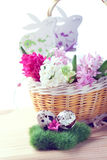 Easter setting - quail eggs and hyacinth flowers Stock Photo