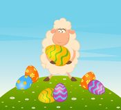 Easter sheep with colored egg Stock Photo
