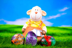 Easter sheep with Easter eggs. In green gras Stock Image
