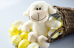 Easter sheep and eggs in basket Royalty Free Stock Images