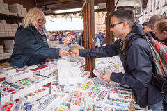 Easter Shopping - Vendor receives payment Stock Photo