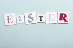 Easter signboard. Handwritten colors letters word. Light blue backgro Stock Photo