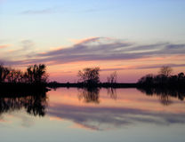 Easter Sky. Pastel sky reflected over water stock images