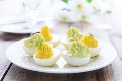 Easter snack^ Eggs stuffed with cheese and avocado mousse Stock Photo