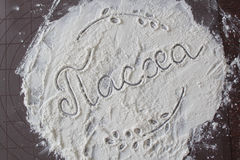 Easter soon. Flour on the table and the written word `Easter Royalty Free Stock Photo