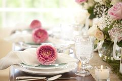 Easter and special occasion dining place setting. With beautiful rose bouquet centerpieces Royalty Free Stock Images