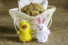 Easter Spiced Cookies. An image of a small basket with Spiced Cookies with a chick and bunny on a hessian background Royalty Free Stock Image