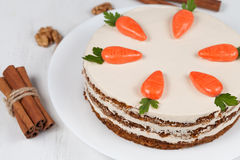 Easter sponge cake with carrots and icing Stock Photos