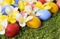 Painted easter eggs hidden among spring flowers Stock Photo