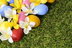 Easter eggs spring flower bed background border, green grass copy space Stock Photo