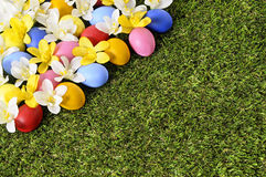 Easter eggs spring corner background border, flower bed, green grass copy space Royalty Free Stock Photo