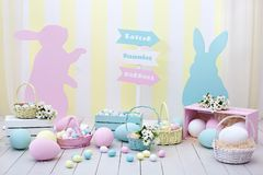 Easter and spring decor. Large multi-colored eggs and Easter bunny. royalty free stock photos